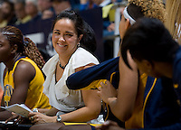 California assistant coach Kai Felton smiles with Layshia Clarendon of California during the game against St. Mary's at Haas Pavilion in Berkeley, California on November 15th, 2012.  California defeated St. Mary's, 89-41.