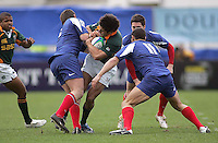 South African centre Francois Hougaard is tacked during the Division A U19 World Championship clash at Ravenhill.