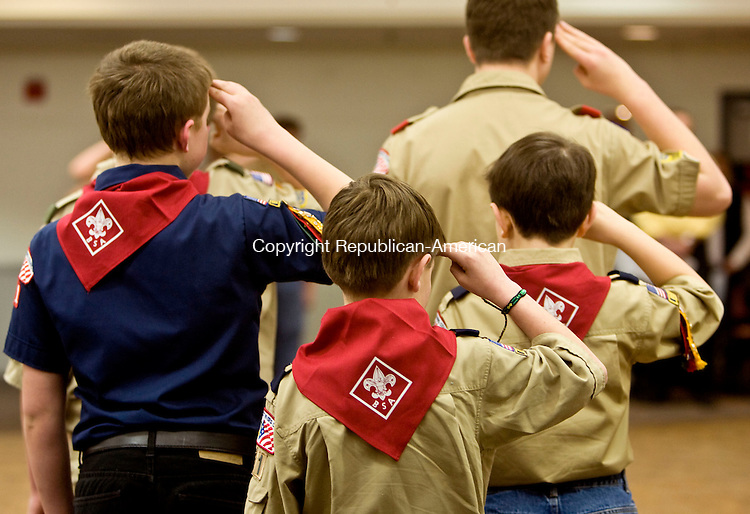BANTAM, CT - 24 MARCH 2010 -032410JT11-<br /> Boy Scouts from Troop 29 begin their meeting with the Pledge of Allegiance at the Bantam Firehouse on Wednesday.<br /> Josalee Thrift Republican-American