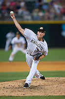 Charlotte Knights relief pitcher Tim Crabbe (23) in action against the Indianapolis Indians at BB&T BallPark on June 20, 2015 in Charlotte, North Carolina.  The Knights defeated the Indians 6-5 in 12 innings.  (Brian Westerholt/Four Seam Images)
