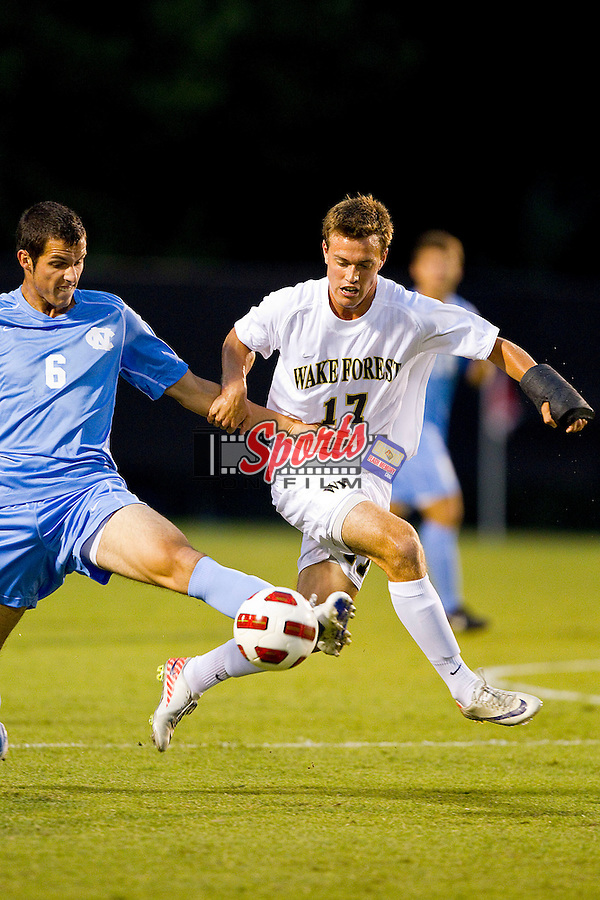 Andy Lubahn #17 of the Wake Forest Demon Deacons tries to take the ball away from Matt Hedges #6 of the North Carolina Tar Heels at Spry Soccer Stadium on September 16, 2011 in Winston-Salem, North Carolina.  The Tar Heels defeated the Demon Deacons 1-0.  (Brian Westerholt / Sports On Film)