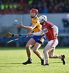 Peter Duggan of Clare in action against Eoin Murphy of Cork during their Munster Hurling League game at Cusack Park. Photograph by John Kelly.