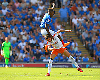 Jamal Lowe of Portsmouth lands on the back of Dan Potts of Luton Townl during Portsmouth vs Luton Town, Sky Bet EFL League 1 Football at Fratton Park on 4th August 2018