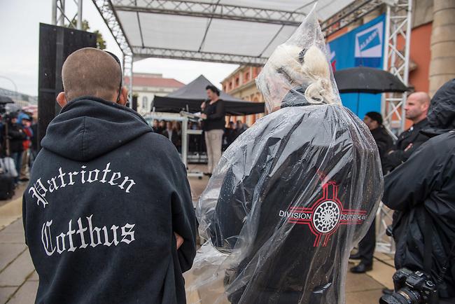 AfD-Kundgebung in Potsdam.<br /> Ca. 70 AfD-Anhaenger kamen am Samstag den 9. September 2017 zu einer Wahlveranstaltung der rechtsnationalistischen &quot;Alternative fuer Deutschland&quot;, AfD. Unter den Teilnehmern waren u.a. Neonazis die &quot;Patrioten Cottbus&quot; oder die sog. &quot;Schwarze Sonne&quot;, ein Zeichen der SS auf ihren Jacken trugen. Offiziell hatte die AfD die Kundgebung als Gruendung einer rechten Gewerkschaft namens &quot;Alternativer Arbeitnehmerverband Mitteldeutschland&quot; (Alarm) in Brandenburg deklariert.<br /> 500 Menschen protestierten friedlich gegen die Veranstaltung.<br /> Im Bild vlnr: Lutz Mamcarz mit der Aufschrift &quot;Partioten Cottbus&quot; auf der Jacke und Sylvia Fechner mit der &quot;Schwarzen Sonne&quot;, dem SS-Symbol, auf der Jacke. <br /> 9.9.2017, Potsdam<br /> Copyright: Christian-Ditsch.de<br /> [Inhaltsveraendernde Manipulation des Fotos nur nach ausdruecklicher Genehmigung des Fotografen. Vereinbarungen ueber Abtretung von Persoenlichkeitsrechten/Model Release der abgebildeten Person/Personen liegen nicht vor. NO MODEL RELEASE! Nur fuer Redaktionelle Zwecke. Don't publish without copyright Christian-Ditsch.de, Veroeffentlichung nur mit Fotografennennung, sowie gegen Honorar, MwSt. und Beleg. Konto: I N G - D i B a, IBAN DE58500105175400192269, BIC INGDDEFFXXX, Kontakt: post@christian-ditsch.de<br /> Bei der Bearbeitung der Dateiinformationen darf die Urheberkennzeichnung in den EXIF- und  IPTC-Daten nicht entfernt werden, diese sind in digitalen Medien nach &sect;95c UrhG rechtlich geschuetzt. Der Urhebervermerk wird gemaess &sect;13 UrhG verlangt.]