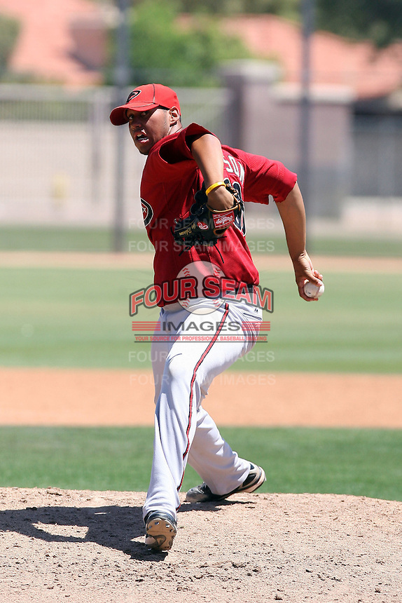 Greg Robinson #38 of the Arizona Diamondbacks plays in an extended spring training game against the Chicago Cubs at the Cubs minor league complex on April 22, 2011  in Mesa, Arizona. .Photo by:  Bill Mitchell/Four Seam Images.