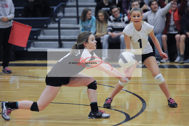 Kaylee Barch returns a serve against Chuiak as teammate Rachel Chaffey watches at Eagle River High School Wednesday, October 26, 2016. Photo for the Star by Michael Dinneen