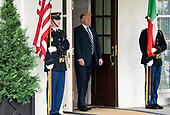 United States President Donald J. Trump awaits the arrival of Prime Minister Giuseppe Conte of Italy who will be at the White House for talks in Washington, DC  on Monday, July 30, 2018.<br /> Credit: Ron Sachs / CNP