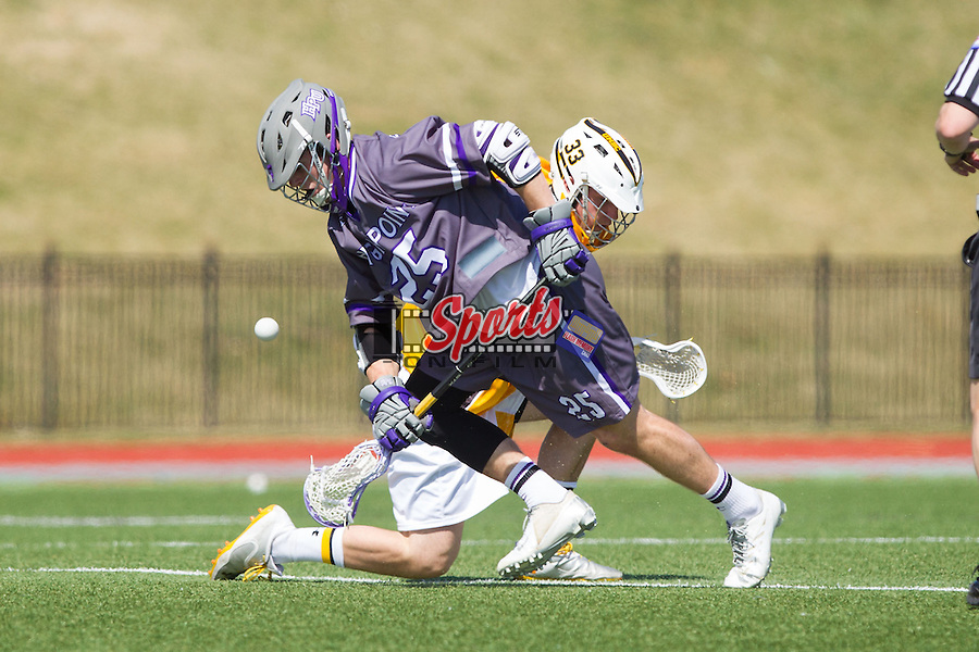 Jamie Piluso (25) of the High Point Panthers wins a face-off against Phil Poe (33) of the UMBC Retrievers at Vert Track, Soccer & Lacrosse Stadium on March 15, 2014 in High Point, North Carolina.  The Panthers defeated the Retrievers 17-15.   (Brian Westerholt/Sports On Film)