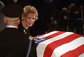 Former first lady Nancy Reagan sheds a tear over the casket of her husband, former United States President Ronald Reagan in the rotunda of the United States Capitol in Washington, D.C. on June 9, 2004.<br /> Credit: Ron Sachs / CNP