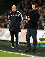(L-R) Swansea manager Alan Curtis and Watford manager Quinque Sanchez Flores during the Barclays Premier League match between Swansea City and Watford at the Liberty Stadium, Swansea on January 18 2016