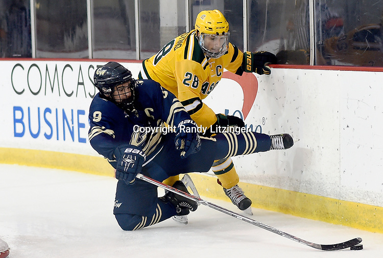 George Washington's Will Yerkovich (9) is hit by George Mason's Tyler D'Agostino (28) behind the net. George Mason defeated George Washington 5-2 on 9-22-18.<br /> <br /> Photo by Randy Litzinger