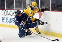 George Washington's Will Yerkovich (9) is hit by George Mason's Tyler D'Agostino (28) behind the net. George Mason defeated George Washington 5-2 on 9-22-18.<br />