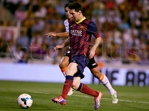 01.09.2013 Valencia, Spain. Forward Lionel Messi of FC Barcelona (L)  is challenged by Defender Ricardo Costa of Valencia CF during the Spanish La Liga game between Valencia and Barcelona from the Mestalla Stadium.