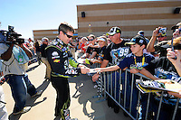 Carl Edwards (#99) signs autographs for the fans.