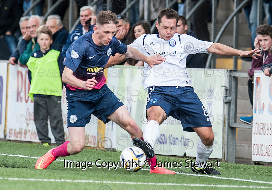 Morton's Decaln McManus holds off Forfar's Derek Young.