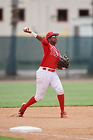 GCL Phillies East third baseman Edgar Made (24) throws to first base during a game against the GCL Blue Jays on August 10, 2018 at Carpenter Complex in Clearwater, Florida.  GCL Blue Jays defeated GCL Phillies East 8-3.  (Mike Janes/Four Seam Images)
