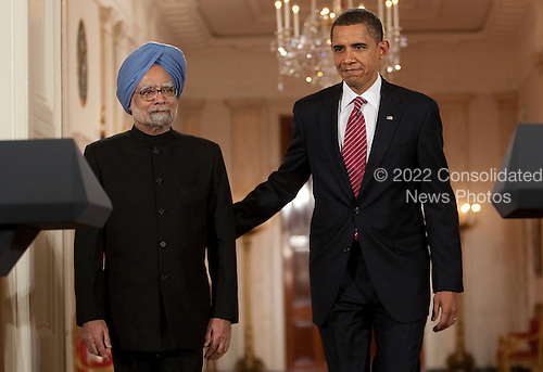 Washington, DC - November 24, 2009 -- United States President Barack Obama, right, and Manmohan Singh, India's prime minister, walk down the Crosshall to the East Room of the White House in Washington, D.C., U.S., on Tuesday, November 24, 2009. Singh was welcomed to the White House this morning by Obama for a state visit where the two leaders will have discussions on curbing nuclear weapons, climate change and trade. .Credit: Andrew Harrer - Pool via CNP