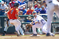Florida Gators first baseman Peter Alonso (20) catches a pick off attempt as Virginia Cavaliers baserunner Adam Haseley (7) heads back to first in Game 11 of the NCAA College World Series on June 19, 2015 at TD Ameritrade Park in Omaha, Nebraska. The Gators defeated Virginia 10-5. (Andrew Woolley/Four Seam Images)