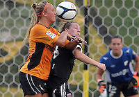 BOYDS, MARYLAND-JULY 07,2012:  Mikaela Howell (8) of DC United Women loses a header to Lauren Hettinger (21) of Dayton Dutch Lions during a W League game at Maryland Soccerplex, in Boyds, Maryland. DC United women won 4-1.