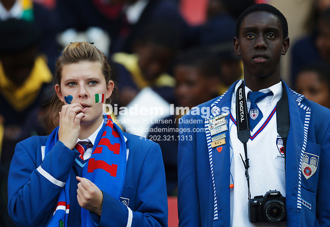 JOHANNESBURG, SOUTH AFRICA - JUNE 24:  School uniformed spectators watch the action at the FIFA World Cup Group F match between Italy and Slovakia at Ellis Park Stadium on June 24, 2010 in Johannesburg, South Africa.  Editorial use only.  Commercial use prohibited.  No push to mobile device usage.  (Photograph by Jonathan Paul Larsen)