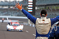 Christian Fittipladi welcomes co-driver Joao Barbosa to pit road after winning the Brickyard Grand Prix, Indianapolis Motor Speedway, Indianapolis, Indiana, July 2014.  (Photo by Brian Cleary/www.bcpix.com)