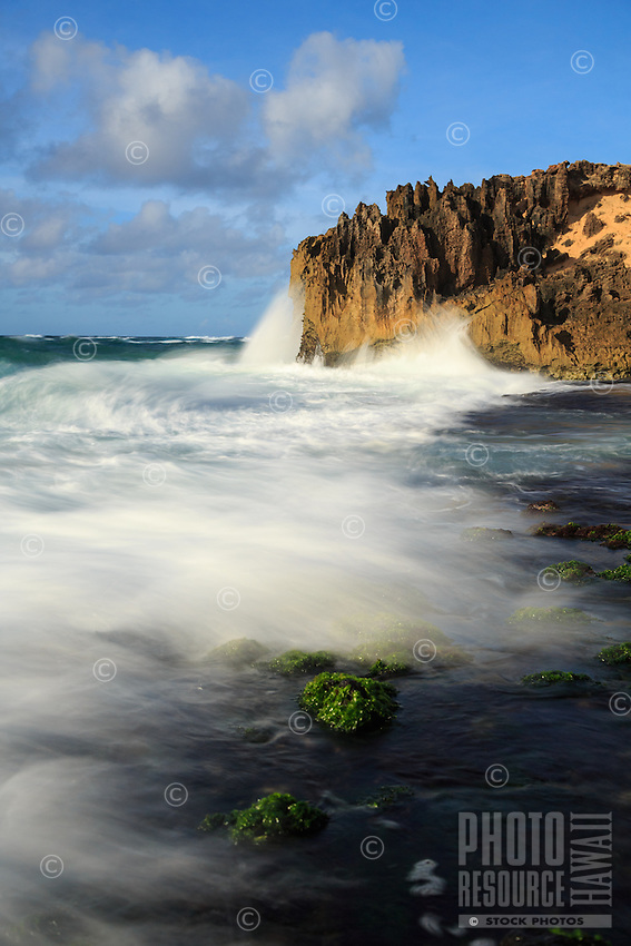 The surf rushes onto the rocky shore along the Maha'ulepu Heritage Trail, southern Kaua'i.