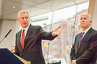 New York Mayor Bill de Blasio, left, and NYPD Commissioner James O'Neill with other high-ranking members of the NYPD brief the media at a press conference on 2016 crime statistics at the Brooklyn Museum on Wednesday, January 4, 2017. 2016 annual shooting incidents fell below 1000 for the first time ever as well as the lowest incidences of reported crime since the introduction of Compstat. (© Richard B. Levine)