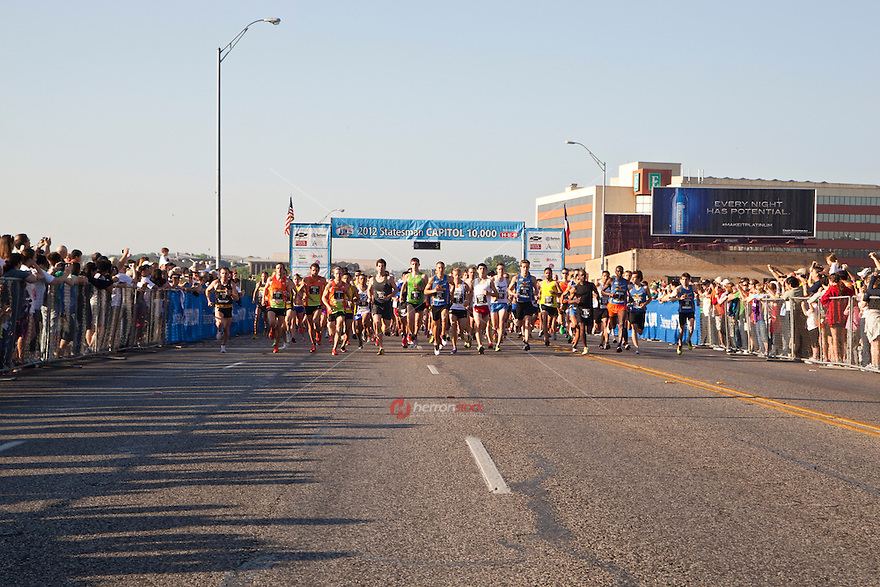 Runners at start of 10K race in downtown Austin, Texas