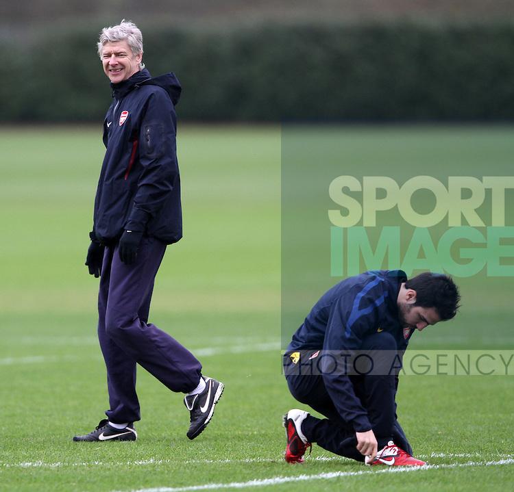 Arsenals Arsene Wenger during training watches Cesc Fabregas