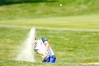 Kevin Na hits out of the bunker on the 18th fairway during the 2016 U.S. Open in Oakmont, Pennsylvania on June 17, 2016. (Photo by Jared Wickerham / DKPS)