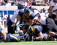 September 8, 2012: California's Eric Stevens rushes through swarm of Southern Utah's linemen during a game at Memorial Stadium, Berkeley, Ca