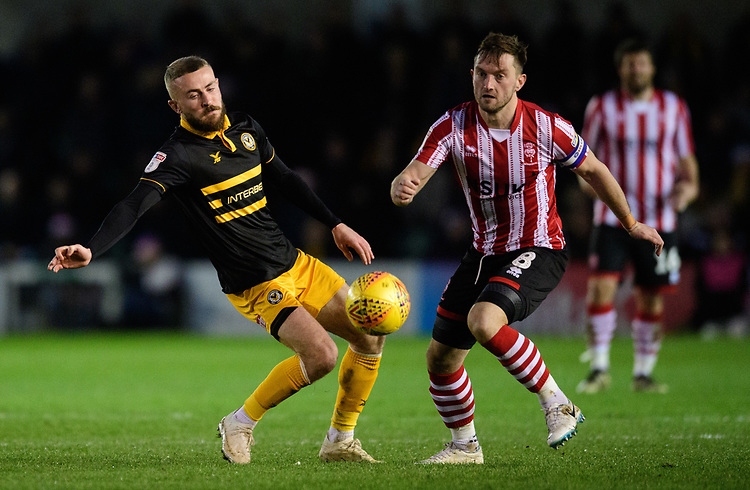 Lincoln City's Lee Frecklington vies for possession with Newport County's Dan Butler<br /> <br /> Photographer Chris Vaughan/CameraSport<br /> <br /> The EFL Sky Bet League Two - Lincoln City v Newport County - Saturday 22nd December 201 - Sincil Bank - Lincoln<br /> <br /> World Copyright © 2018 CameraSport. All rights reserved. 43 Linden Ave. Countesthorpe. Leicester. England. LE8 5PG - Tel: +44 (0) 116 277 4147 - admin@camerasport.com - www.camerasport.com