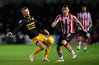 Lincoln City's Lee Frecklington vies for possession with Newport County's Dan Butler<br /> <br /> Photographer Chris Vaughan/CameraSport<br /> <br /> The EFL Sky Bet League Two - Lincoln City v Newport County - Saturday 22nd December 201 - Sincil Bank - Lincoln<br /> <br /> World Copyright &copy; 2018 CameraSport. All rights reserved. 43 Linden Ave. Countesthorpe. Leicester. England. LE8 5PG - Tel: +44 (0) 116 277 4147 - admin@camerasport.com - www.camerasport.com