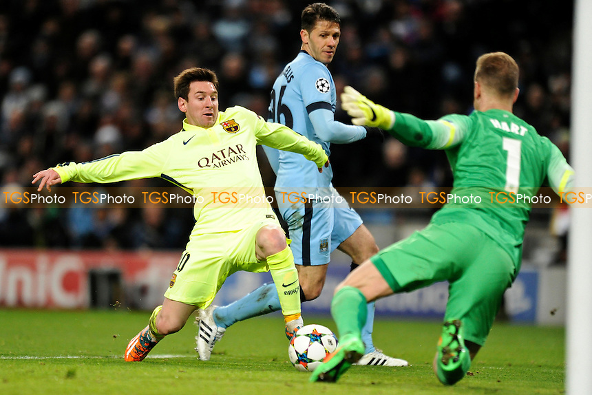 Lionel Messi of Barcelona tries to poke the ball past Joe Hart of Manchester City - Manchester City vs Barcelona - UEFA Champions League Round of 16 1st Leg Football at the Etihad Stadium, Greater Manchester - 24/02/15 - MANDATORY CREDIT: Greig Bertram/TGSPHOTO - Self billing applies where appropriate - contact@tgsphoto.co.uk - NO UNPAID USE