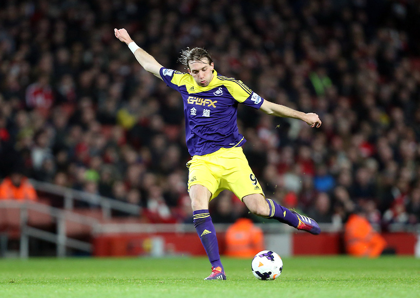 Swansea City's Michu <br /> <br /> Photo by Kieran Galvin/CameraSport<br /> <br /> Football - Barclays U21 Premier League - Arsenal v Swansea City - Tuesday 25th March 2014 - The Emirates Stadium - London<br /> <br /> &copy; CameraSport - 43 Linden Ave. Countesthorpe. Leicester. England. LE8 5PG - Tel: +44 (0) 116 277 4147 - admin@camerasport.com - www.camerasport.com