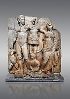 Roman Sebasteion relief sculpture of emperor Augustus and Goddess Victory, Aphrodisias Museum, Aphrodisias, Turkey. <br /> <br /> The naked emperor Augustus stands in majesty with the winged goddess Victory(Nike). He carried a spear and has an eagle, the bird representing Zeus, at his feet. Victory is crowning a military trophy - a rough post with enemy armour attached to it. Beneath the trophy is a barbarian captive, his hands tied behind his back.