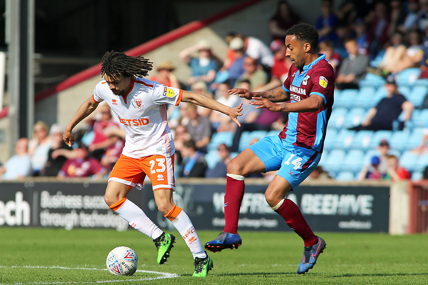 Blackpool's Nya Kirby gets away from Scunthorpe United's James Perch<br /> <br /> Photographer David Shipman/CameraSport<br /> <br /> The EFL Sky Bet League One - Scunthorpe United v Blackpool - Friday 19th April 2019 - Glanford Park - Scunthorpe<br /> <br /> World Copyright © 2019 CameraSport. All rights reserved. 43 Linden Ave. Countesthorpe. Leicester. England. LE8 5PG - Tel: +44 (0) 116 277 4147 - admin@camerasport.com - www.camerasport.com