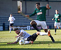 Hib's Dominique Malonga is challenged by Raith Rovers' Craig Barr.