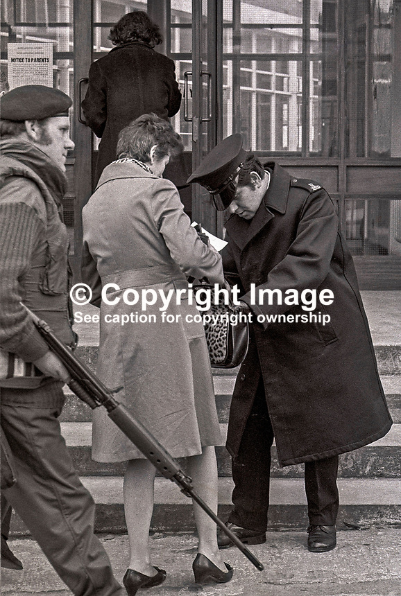 Army & police on security duty at polling station in N Ireland school during the 1973 Border Poll on N Ireland's Future. The school in question is Rosetta Primary in Belfast. 197303080042c..Copyright Image from Victor Patterson, 54 Dorchester Park, Belfast, UK, BT9 6RJ..Tel: +44 28 9066 1296.Mob: +44 7802 353836.Voicemail +44 20 8816 7153.Skype: victorpattersonbelfast.Email: victorpatterson@mac.com.Email: victorpatterson@ireland.com (back-up)..IMPORTANT: If you wish to use this image or any other of my images please go to www.victorpatterson.com and click on the Terms & Conditions. Then contact me by email or phone with the reference number(s) of the image(s) concerned.