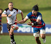 Savelio Ropati spreads the ball to the backline. Counties Manukau Premier 1 McNamara Cup Final between Ardmore Marist and Bombay, played at Navigation Homes Stadium on Saturday July 20th 2019.<br />  Bombay won the McNamara Cup for the 5th time in 6 years, 33 - 18 after leading 14 - 10 at halftime.<br /> Photo by Richard Spranger.
