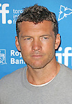 Sam Worthington during the Photo Call for 'Cake' at the the tiff Bell Lightbox during the 2014 Toronto International Film Festival on September 9, 2014 in Toronto, Canada.