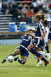 18 June 2004: Thori Bryan (2) knocks the ball away as Christie Rampone (3) sets a pick on Maribel Dominguez (behind Rampone). The Atlanta Beat tied the New York Power 2-2 at the National Sports Center in Blaine, MN in Womens United Soccer Association soccer game featuring guest players from other teams.