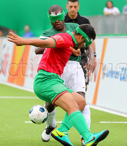 09.09.2016. Rio de Janeiro, Brazil.  Jefinho (L) of Brazil challenges for the ball with Abderrazak Hattab of Morocco during Men's Preliminaries Pool A, Match 1, Team Football 5-a-side, of the Rio 2016 Paralympic Games, Rio de Janeiro, Brazil, 09 September 2016.