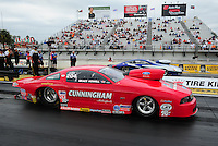 Mar. 10, 2012; Gainesville, FL, USA; NHRA pro stock driver Grace Howell (near lane) races alongside Mark Martino during qualifying for the Gatornationals at Auto Plus Raceway at Gainesville. Mandatory Credit: Mark J. Rebilas-