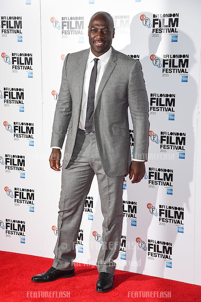 Adewale Akinnuoye-Agbaje at the photocall for &quot;Trumbo&quot; at the Corinthia Hotel, London.<br /> October 8, 2015  London, UK<br /> Picture: Steve Vas / Featureflash