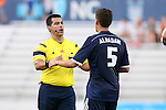 09 July 2014: Referee Ricardo Salazar (left) talks with Carolina's Nazmi Albadawi (5). The Carolina RailHawks of the North American Soccer League played FC Dallas of Major League Soccer at WakeMed Stadium in Cary, North Carolina in the quarterfinals of the 2014 Lamar Hunt U.S. Open Cup soccer tournament. FC Dallas won the game 5-2.