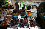 A picture taken on May 15, 2018 shows a Palestinian vendor sells dates at a market during the holy month of Ramadan, in the West Bank city of Nablus. Ramadan is sacred to Muslims because it is during that month that tradition says the Koran was revealed to the Prophet Mohammed. The fast is one of the five main religious obligations under Islam. Muslims around the world will mark the month, during which believers abstain from eating, drinking, smoking and having sex from dawn until sunset. Photo by Ayman Ameen