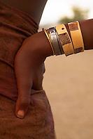 Hand made bracelets adorn the arm of a Himba woman, Kaokoland, northwestern Namibia.