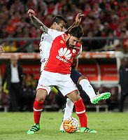 BOGOTÁ -COLOMBIA, 16-02-2016. Jonathan Gomez (Der) jugador del Independiente Santa Fe de Colombia disputa el balón con Raul Caceres (Izq) jugador de Cerro Porteño del Paraguay durante partido de la seguda fase  grupo ocho de la Copa Libertadores de America 2016 jugado en el estadio Nemesio Camacho El Campín de la ciudad de Bogotá./ Jonathan Gomez (R) player of Independiente Santa Fe of Colombia  fights for the ball with Raul Caceres (L) player of Cerro Porteno of Paraguay  during second qualifying Group eight the match for the Copa Libertadores of America 2016 played at Nemesio Camacho El Campin stadium in Bogotá city. Photo: VizzorImage/ Felipe Caicedo  / Staff