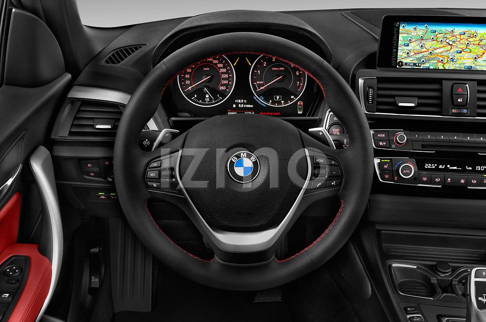 Car pictures of steering wheel view of a 2015 BMW 2 Series  Sport 2 Door Convertible